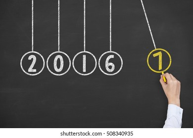 Human Hand Drawing New Year 2017 Energy Concept on Blackboard Background