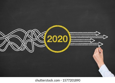 Human Hand Drawing Old Year New Year 2020 on Blackboard Background