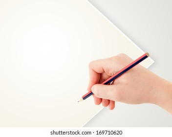 Human hand drawing with pencil on empty white paper template