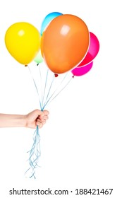human hand gives flying balloons isolated. Holiday background
