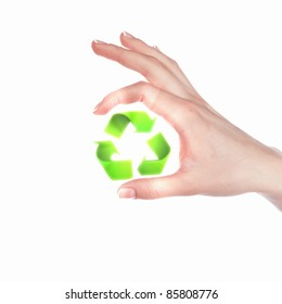 human hand with green eco and recycle symbol