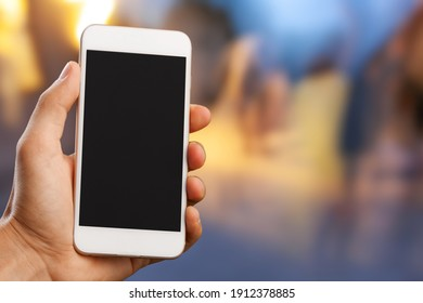 Human hand hold mobile phone with blank screen