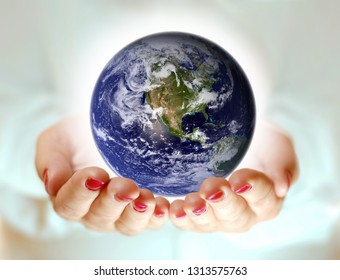 Human hand holding all earth