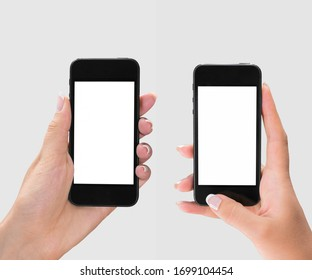 Human hand holding the black smartphones with blank screens