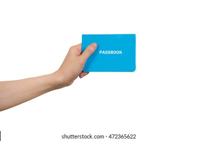 human hand holding blue passbook on isolated white background, Concept of Financial Transactions.