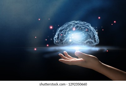 human hand holding brain, Artificial Intelligence, AI Technology, thinking concept.