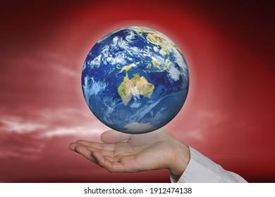 Human hand holding the earth conceptual theme