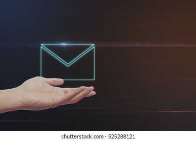 Human Hand Holding E-Mail Icon on Light Motion Background and Lens Flare - Digital 3d Effect Style Color
