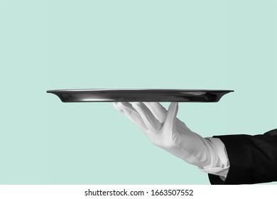 Human hand holding an empty tray