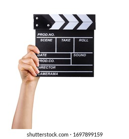 Human hand holding fiilm clapper board isolated on white background with clipping path.