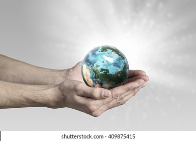 Human hand holding globe