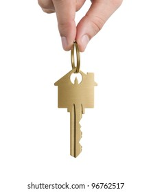 Human hand holding key to a dream house isolated on white