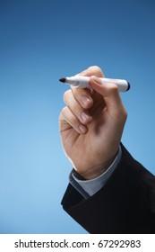 Human hand holding a marker pen