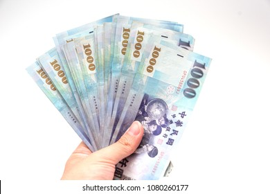 Human hand holding money isolated on white background