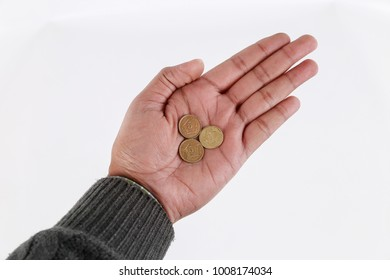 human hand holding a Pakistani coin, isolated on white background
