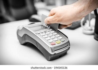 Human hand holding plastic card