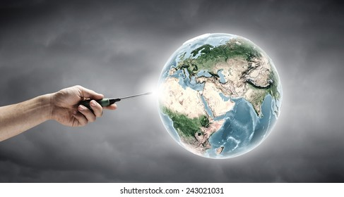 Human hand holding screwdriver. Elements of this image are furnished by NASA