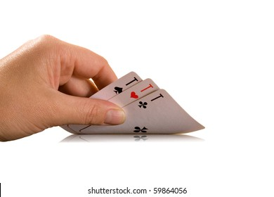 a human hand holding three playing cards