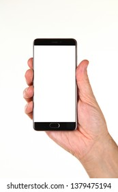Human hand holds a modern smartphone with a blank chromakey screen in a palm. Technology and advertising concept. Detailed closeup studio shot isolated on abstract blurred white background