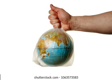 The human hand holds the planet earth in a plastic bag. The concept of pollution by plastic debris. Global warming due to greenhouse effect. Isolated white background