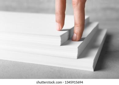 Human hand imitating walking upstairs. Concept of career growth