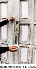Human hand knocking old door for charity. Humanitarian. Make sacrifices. Humanitarian aid
