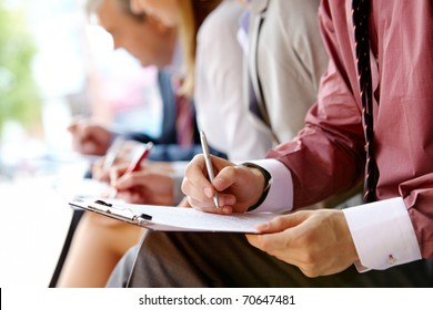 Human hand over paper making notes in working environment