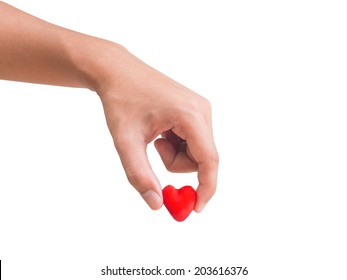 Human hand pick up piece of red heart isolated on white background