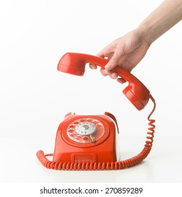 human hand picking up the phone, on white background