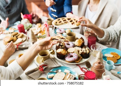 Human hand with piece of fresh sweet pie on background of food on festive table