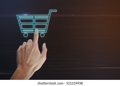 Human Hand Pressing Shopping Cart Icon on Light Motion Background and Lens Flare - Digital 3d Effect Style Color