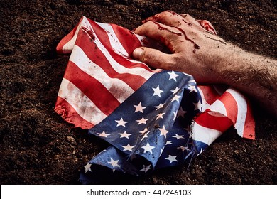 Human hand protect american flag over soil background. Freedom concept