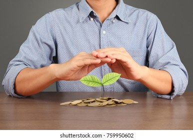human hand putting coin to money, business ideas