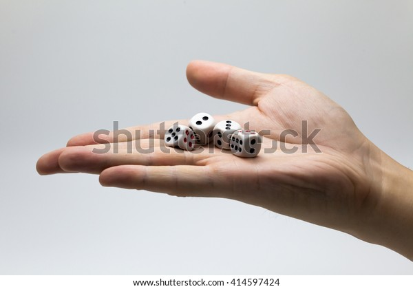 Human hand ready to roll the dice on white isolated background - Try luck, Take Risk or Business concept (Focus on dices)