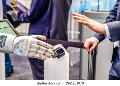 Human hand and robot's as a symbol of connection between people and artificial intelligence technology.