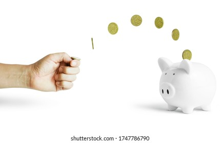 human hand strum a coin into white piggy bank with clipping path