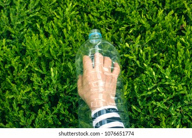 Human hand stuck in plastic bottle. Environmental concept, Plastic issue, Plastic side effect Human