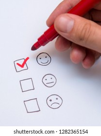Human hand, tick placed on excellent check box. Customer service, satisfaction, survey form