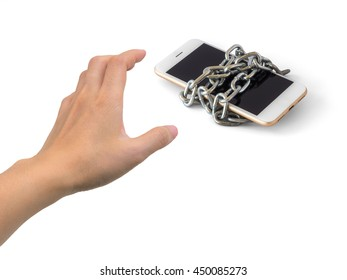 Human hand trying to catch chained smart phone isolate on white background with clipping path and copy space. Concept of social network issues, security, phubbing, smart phone addiction