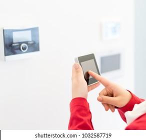 Human hand using smart home device