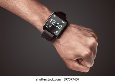 Human hand wearing smart watch. Wearable gadget concept