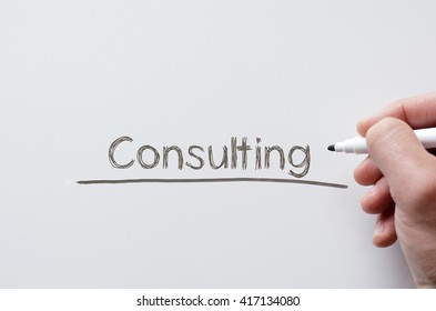 Human hand writing consulting on whiteboard