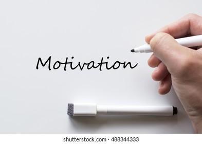 Human hand writing motivation on whiteboard