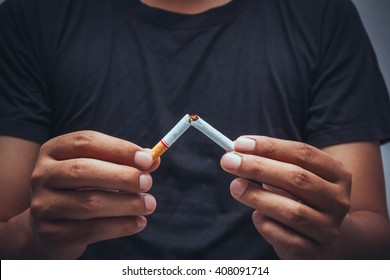 Human hands breaking the cigarette, Concept Quitting smoking,World No Tobacco Day