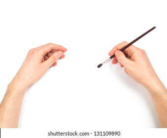 Human hands with brush painting something. On white background