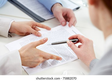 Human hands during discussion of business papers