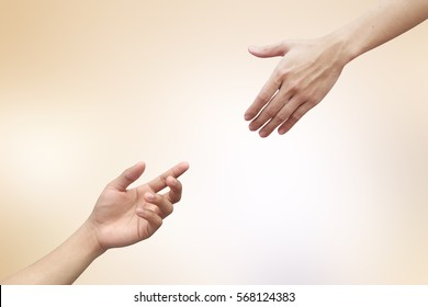 Human hands help together on blur glowing gold backgrounds for faith and belief of religious conceptual.