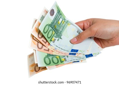 Human hands holding euro money over white background