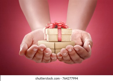 Human hands holding gift for boxing day. Boxing Day Concept