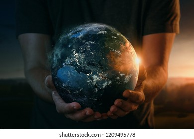 Human hands holding planet earth. Elements of this image furnished by NASA